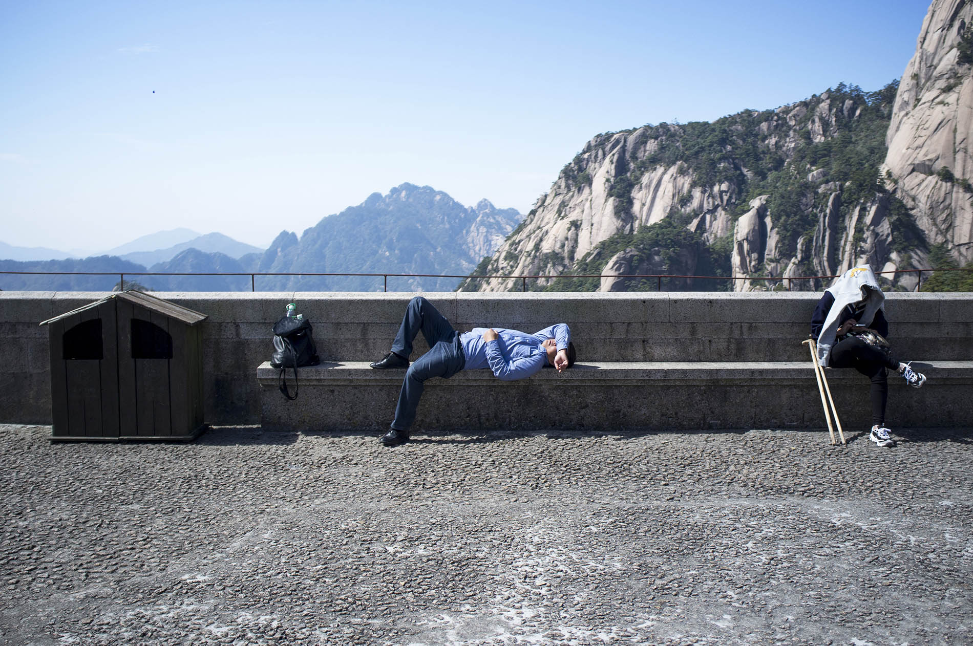 Chinese person occupied with his usual activity – having a nap.