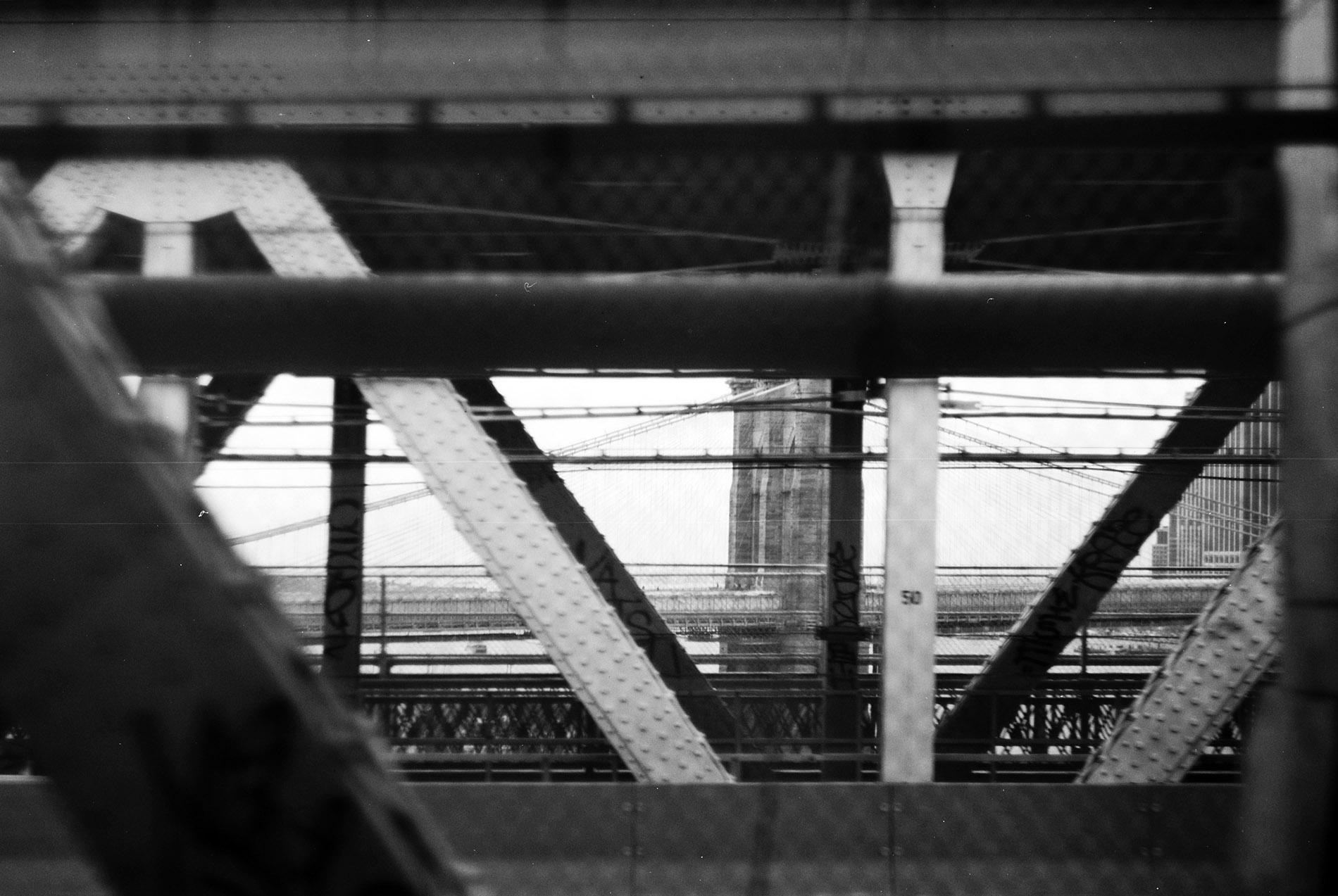 View on the Brooklyn Bridge from the train on Manhattan Bridge.