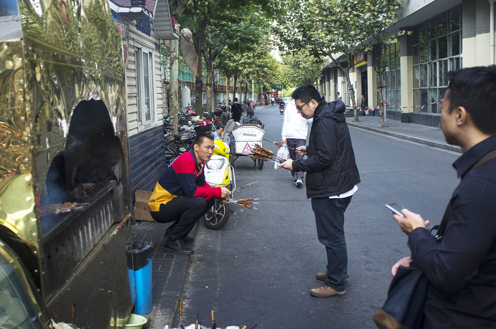 Locals eating on the street.