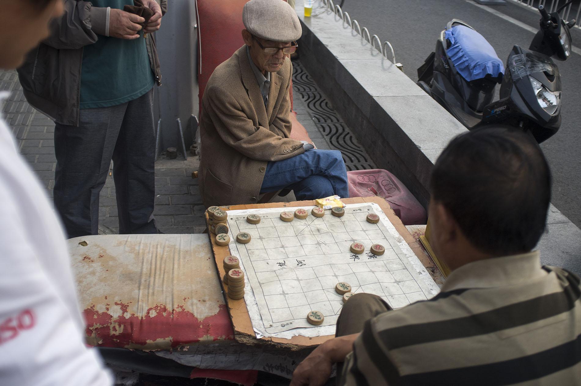 Locals playing Chinese chess.