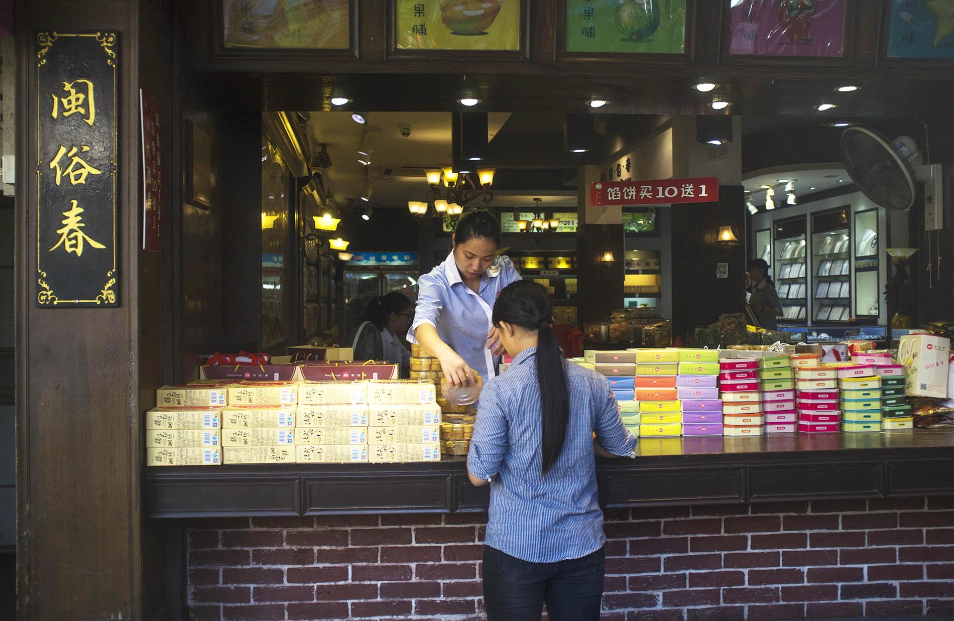 Woman selling marzipan.