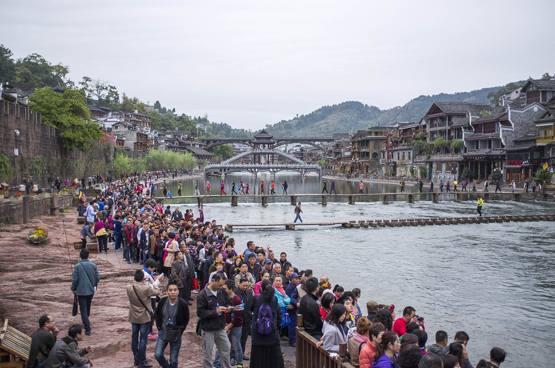 df7138ea9 china-fenghuang_07. The main tourist activity here is boating down the  river and dressing up in the clothes of the Miao minority.