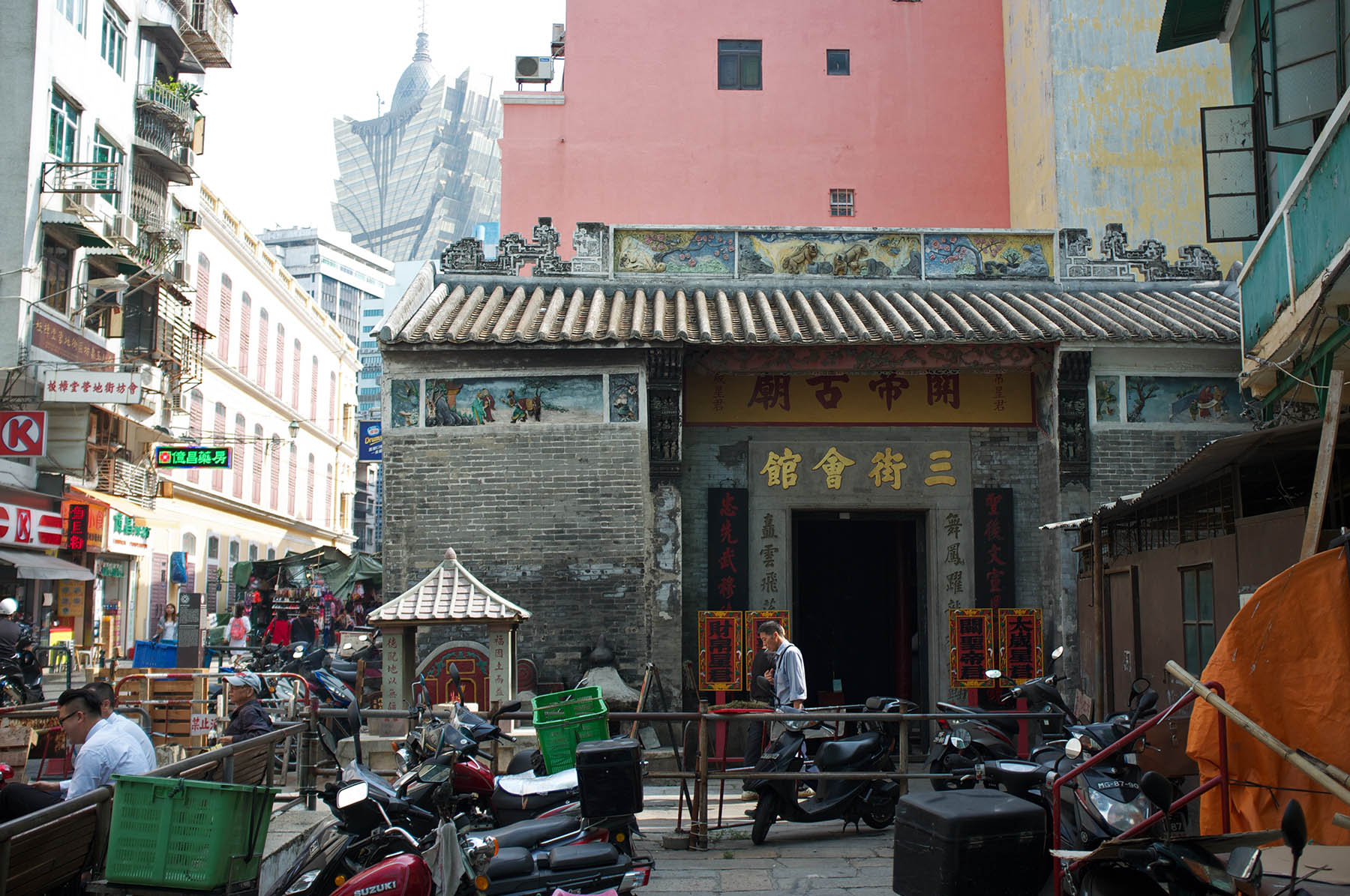 Old Chinese temple surrounded by modern and European architecture.
