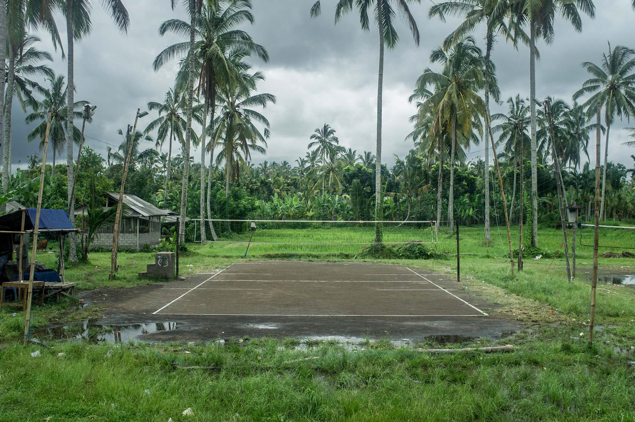 Balinese might have been isolated for centuries however now they practice european sports. Volleyball playground.