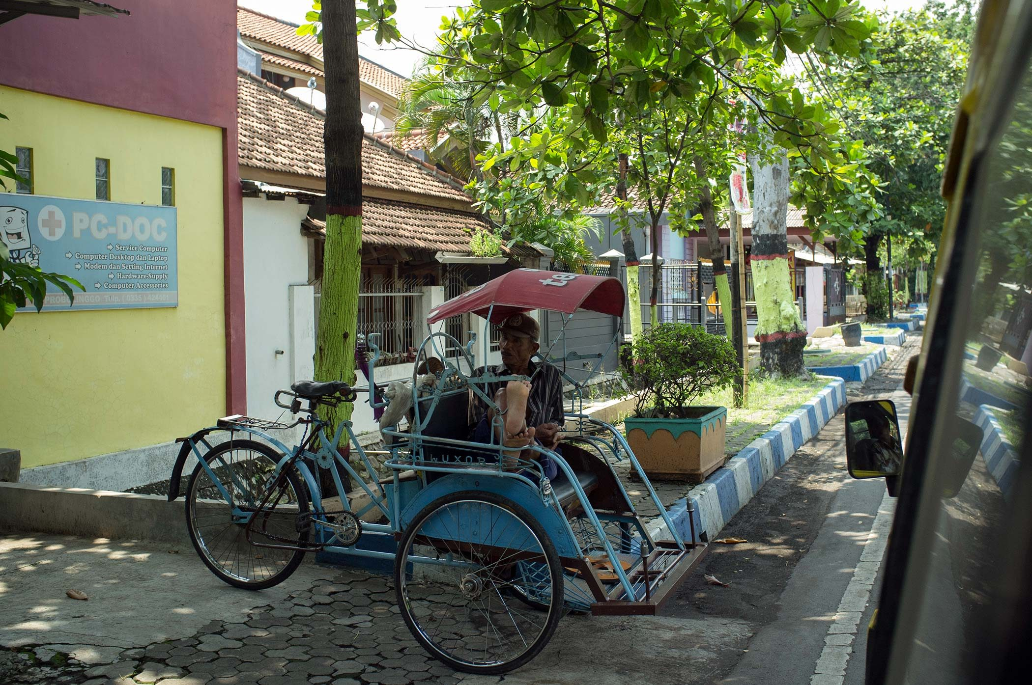 Man resting on the bike-taxi.